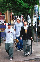 Skateboarders Downtown on Street Corner (thumbnail)