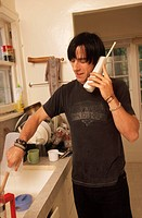 Man in Kitchen on Phone