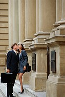 Couple Kissing Outside Building