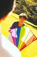 Couple Flying Kite in Park