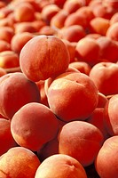 Close_up of a heap of peaches