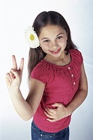 High angle view of a girl making a victory sign