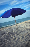 Blue Umbrella On A Warm Sandy Beach