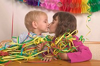 Little Boy And Girl Kissing At A Party