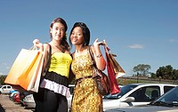 Low angle of young women holding shopping bags, KwaZulu Natal Province, South Africa
