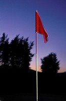 Close_up of a red flag on a golf course