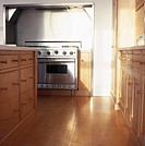 View of a cooking range installed in a wooden kitchen