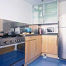 A modern kitchen with a stainless steel cooking range