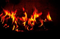 Close_up of a fire lit in a fireplace