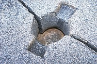 Close_up of a hole cut out in a rock surface