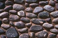 Close-up of a rocks embedded in a wall (thumbnail)