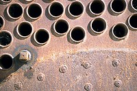 Close_up of rivets and holes on a metal surface