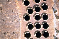 Close-up of rivets and holes on a metal surface (thumbnail)