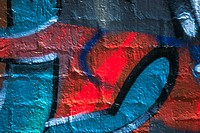 Close_up of graffiti on a brick wall