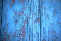 Close_up of paint peeling off a wooden surface