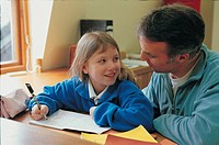 Father and daughter doing homework together (thumbnail)