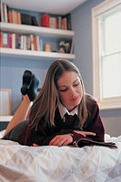 school girl reading a magazine