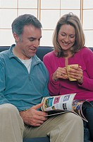 couple reading a magazine together