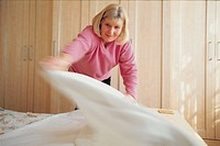 elderly woman changing the linen