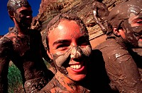 group of friends at a mud bath