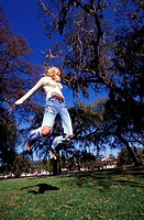 young woman jumping up