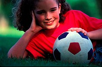 girl posing with a football