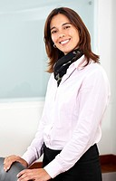 Business woman portrait smiling in an office _ hispanic