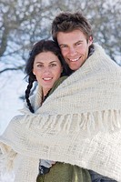 Husband and wife wrapped in blanket