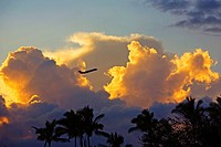 Hawaii, Beautiful clouds a sunset with a silhouette of an airplane.