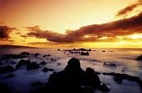 Hawaii, Maui, Sunset over rocky beach, Kahoolawe and Molokini islands in distance, Long exposure.