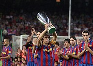 Barcelona, Camp Nou Stadium, 31/08/2009, Carles Puyol, team captain of FC Barcelona, offering recently won UEFA Super Cup to the supporters