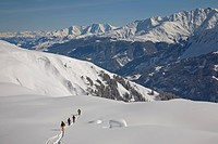 Freeriding on the virgin snow slopes of Disentis, Graubunden, Switzerland. Since a few years this ski resort is extremely populair among a group of yo...
