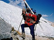 Dutch mountain climber Ronald Naar walking with skis to the basecamp of Huascaran, Cordillera Blanca, Peru.