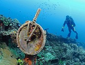 Scuba diver looks at telegraph on deck of Japanese shipwreck Fujikawa Maru, Chuuk, Micronesia, Pacific