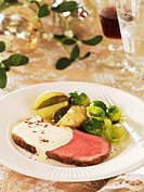Roast beef with potatoes, Brussels sprouts and sauce Christmas