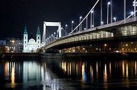 The inner city parish church and Elizabeth Bridge in Budapest at night