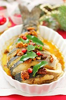 Baked carp with nuts and honey sauce Christmas