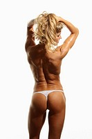 A very fit woman flexes her back