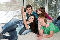 Friends taking self portrait with a mobile phone