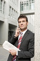 Businessman using mobile phone, waist up