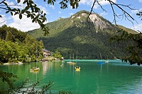 Boats moored near a hotel on Lake Walchensee, Bavaria, Southern Germany, Europe