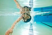 underwater shot of female swimmer doing freestyle stroke