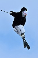 a skier jumping and adopting an elegant posture