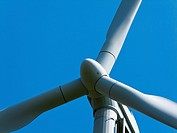 Wind power alternative energy through windmill with blue sky