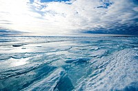During the Arctic spring, the surface of the frozen arctic ocean begins to crack under stress as the ice thins from above and the actioon of currents ...