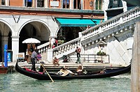 Venetian Gondola on the Grand Canal with the Rialto Bridge from the front