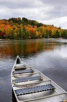 Canoe on a lake at Algonquin Provincial Park in autumn. Ontario, Canada