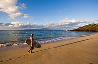 Surfer on Makena Beach or Big Beach, Maui, Hawaii, United States