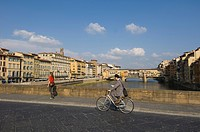 Mopeds crossing the Arno River, Florence, Tuscany, Italy