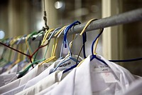 Doctor white clothes hanging in hospital laundry